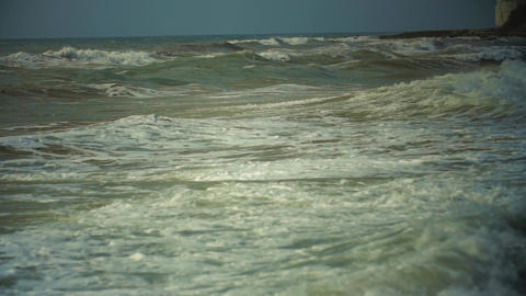 Sea wave. The black sea in the spring. Muddy sea water. Slow wave movement Live Action