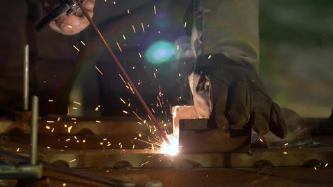 Sparks and smoke from welding metals. Welding of metal structures Live Action