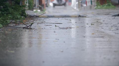 Establishing shot of an alleyway during a hard rain Footage