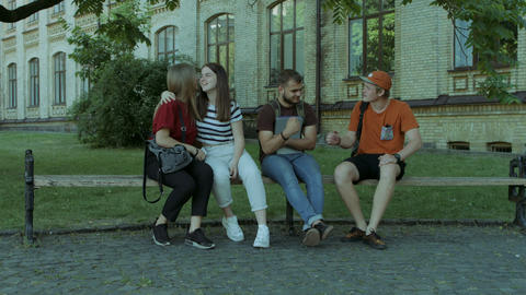 College friends meeting in university campus Footage