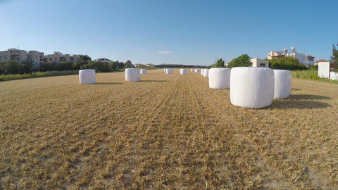 Drone flying over field counting bales of hay for report on harvested crops Footage