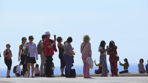 Crowds of tourists admiring and taking photo of beautiful Mediterranean view Footage