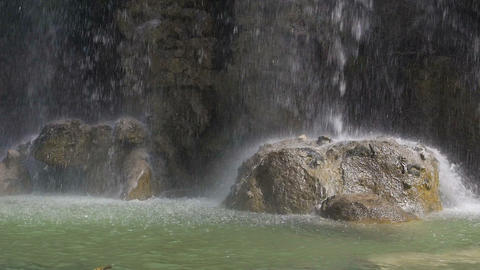 Water dropping on stones, waterfall in the park of Castle Hill in Nice, France Footage
