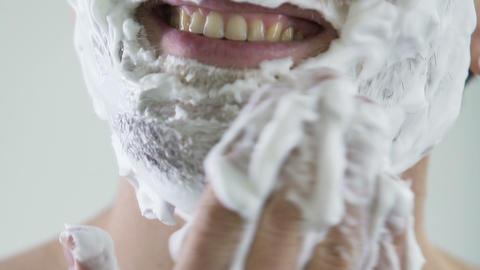 Super close up of happy man applying shaving foam, morning ritual, skincare Live Action