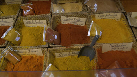 Large assortment of various condiments, herbs and spices at ethnic shop, market Live Action