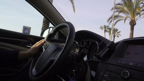 Successful man riding car along promenade of Nice, slowing down at traffic light Footage