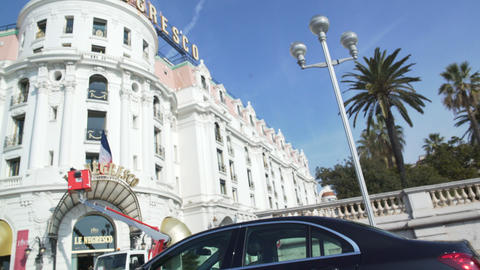 View from vehicle window to luxury hotel near Promenade des Anglais in Nice Footage