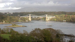 Menai Bridge and the Straits at sunset Isle of Anglesey North Wales Footage