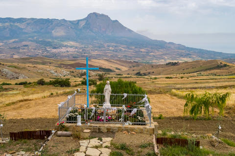 Small sanctuary of the Virgin Mary facing the fields and mountai Photo