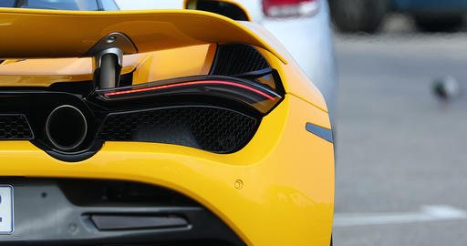 Rear View Of A Yellow Supercar Live Action