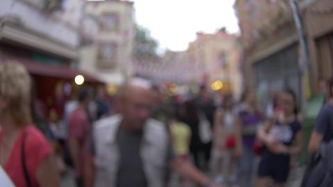 Walking among people in street festival - defocused blurry concept footage Footage
