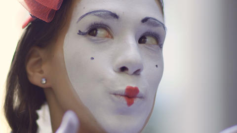 Pretty girl mime playing her hands and facial expressions Footage