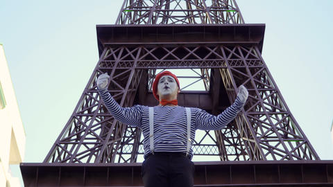 Man mime gesticulating his hands as a conductor in the theater ビデオ