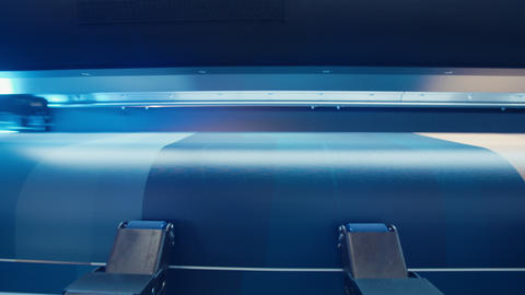 Large format printer printing on a roll of paper at high speed Footage
