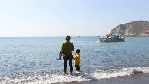 Poor mother with child peering at boat where father working to earn for living Footage