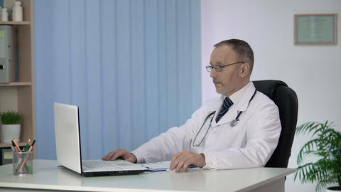 Doctor conducting online consultations pondering on difficult case of patient Footage