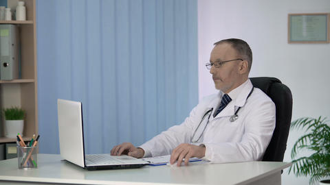 Physician reviewing patient medical records, surprised by test results, science Footage
