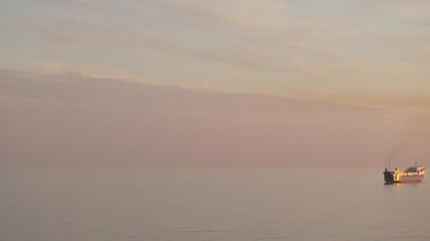 One big ocean cargo ship at beautiful sunset Footage