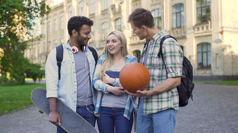 Young men chatting and flirting with pretty blonde near college, students Live Action