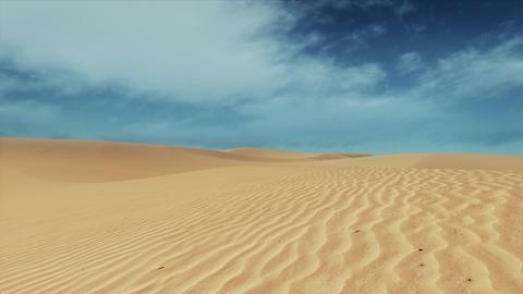 Motion through sandy desert dunes at daytme GIF