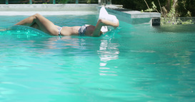 Attractive woman relaxing on a lilo Footage
