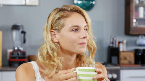 Blonde woman drinking a cup of coffee Footage