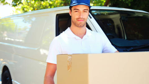 Delivery man carrying a parcel Footage