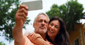 Smiling couple taking selfie Footage