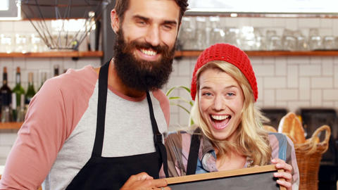 Hipster couple holding open sign Footage