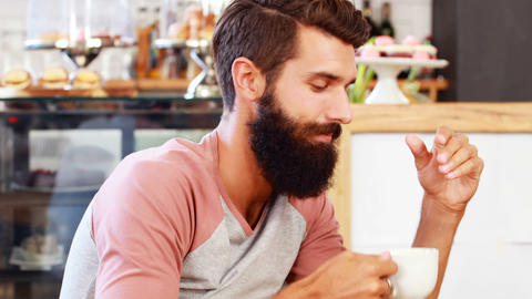 Portrait of hipster man drinking coffee Live Action