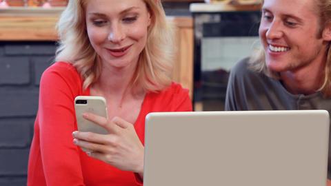 Girlfriend showing smartphone to boyfriend Footage