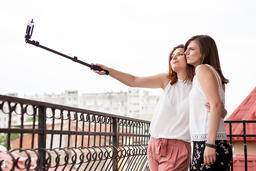 Happy and positive female friends taking a selfie Photo