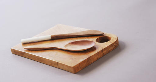 Wooden spoon and spatula on wooden board Footage