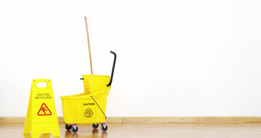 Mopping bucket with caution sign Live Action