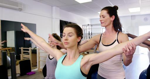 Beautiful women exercising in fitness studio Footage