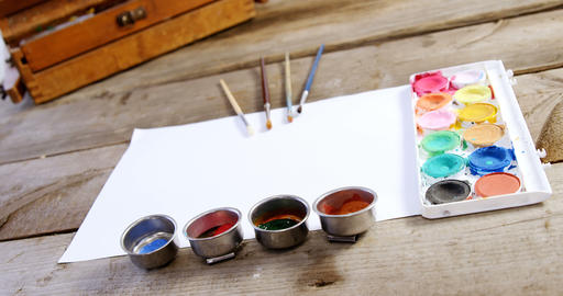 Watercolor paint and paintbrushes with canvas Live Action