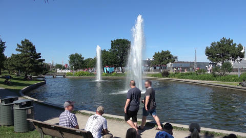 People sitting at water fountain. Blurred faces. Montreal Old Port Footage