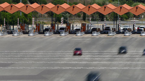 Traffic in a toll.Time Lapse. Long exposure.Top and front view Live Action