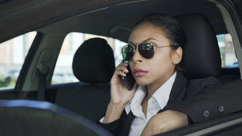 Businesswoman in car talking over mobile phone gesturing angrily, failed deal Footage