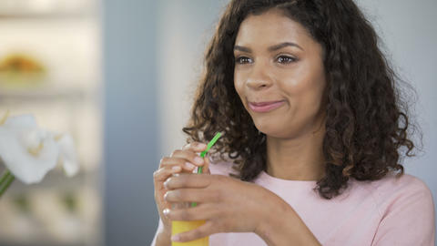 Beautiful healthy woman drinking juice and smiling, body care, rich nutrition Live Action