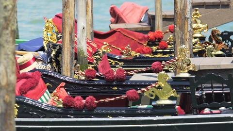 Beautifully adorned black boats swaying on turquoise waves, tourist attraction Live Action