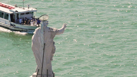 Tourist ferry going across river passing statue of a saint, sightseeing tour Footage