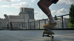 Legs of young man skateboarder doing skateboard trick in daytime in summer Footage