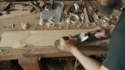 Skilled craftsman working in a workshop Archivo