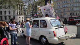 Ice cream taxi selling ice cream from a converted London taxi Trafalgar Square Footage