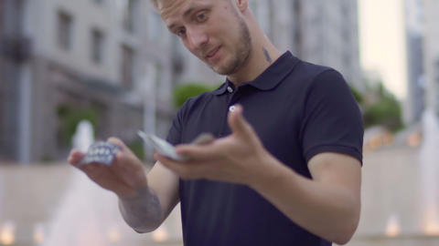Professional illusionist skillfully moving playing cards in hands Footage