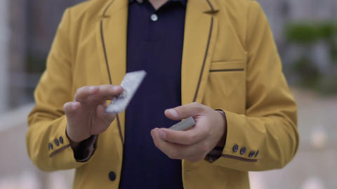 Illusionist with playing cards in hands Footage