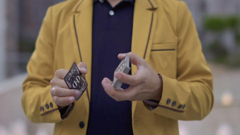 Illusionist with playing cards in hands Stock Video Footage