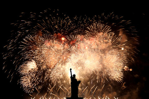 Silhouette statue of liberty on firework background Photo