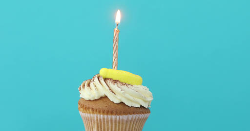 Birthday cupcake with a single yellow candle Footage